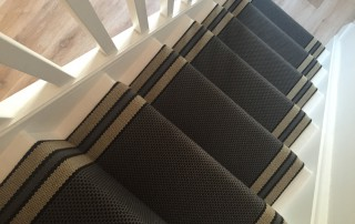 A staircase profesionally finished with a runner